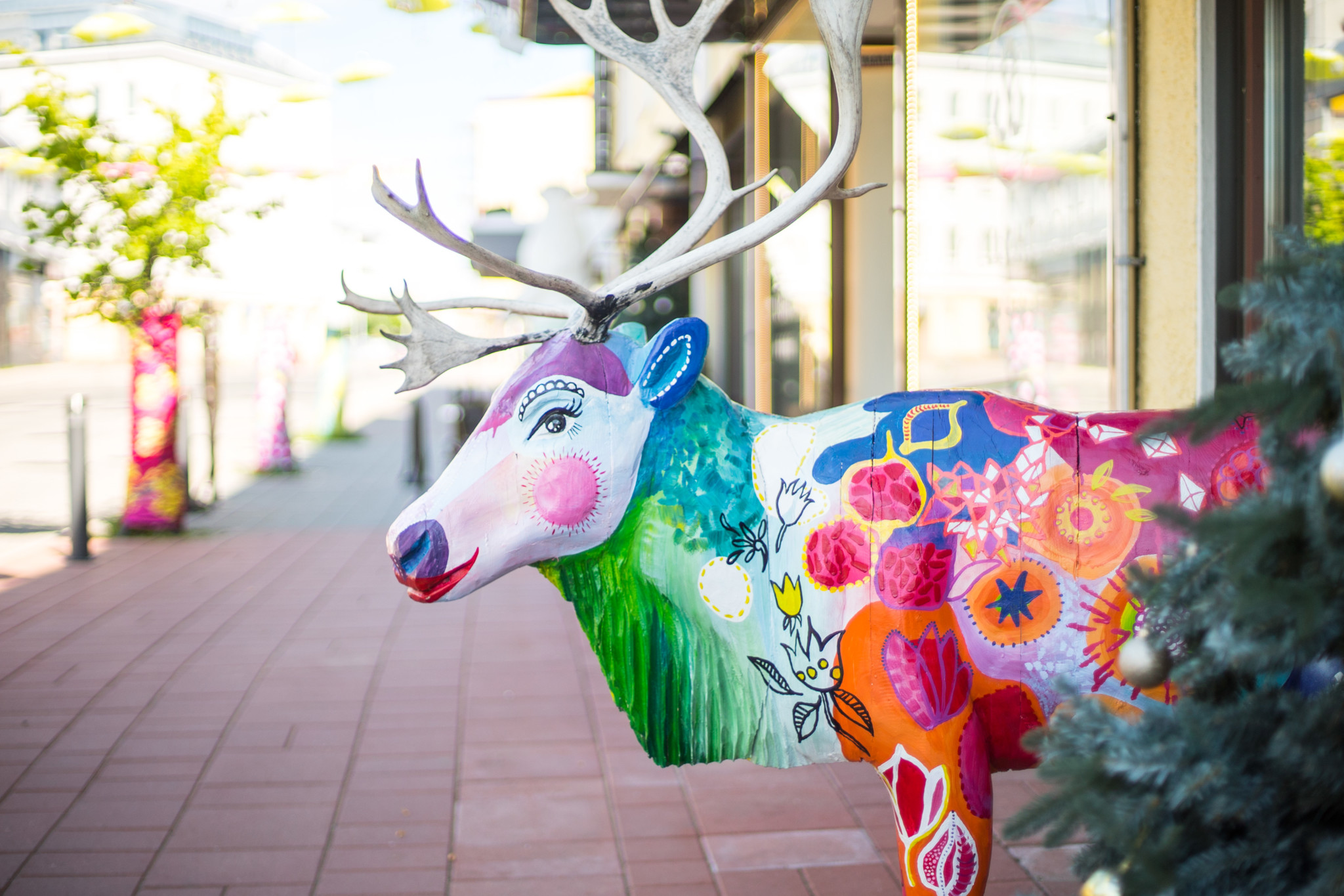 Colorful Reindeer Sculpture in front of Arctic Light Hotel in Rovaniemi Lapland Finland
