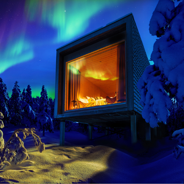 The Northern lights dancing above Arctic TreeHouse Hotel suites in Rovaniemi Lapland Finland