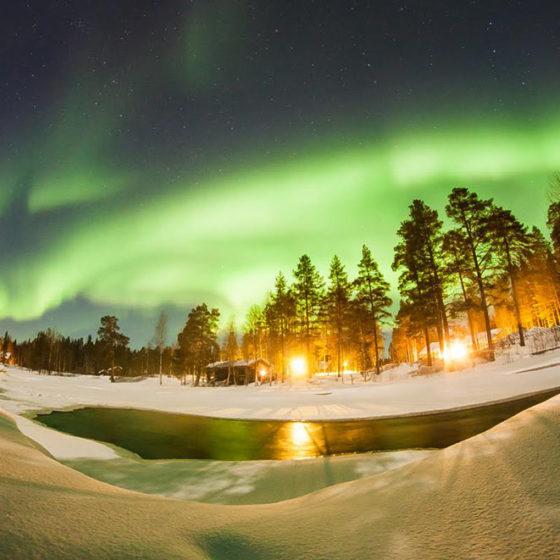 Auroras at Arctic Circle Wilderness Lodge, Wild Nordic Finland in Rovaniemi