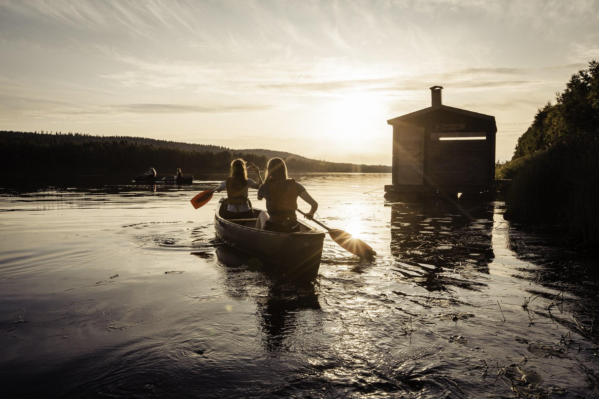 Canoeing with Happy Fox Photo by All About Lapland