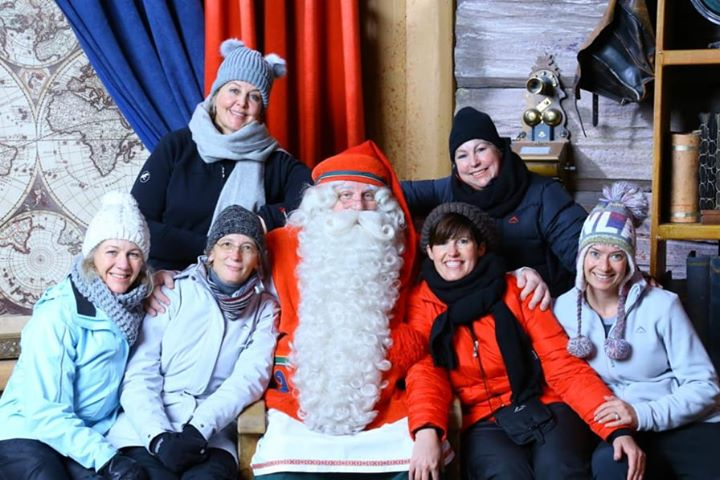 Carin from South Africa with Santa Claus in Rovaniemi Lapland Finland
