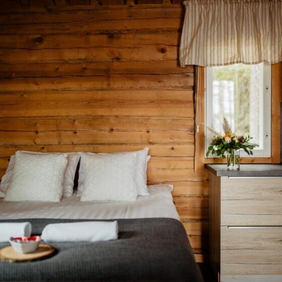 Cozy bed in Bearhill husky wilderness cabin, Rovaniemi, Lapland, Finland
