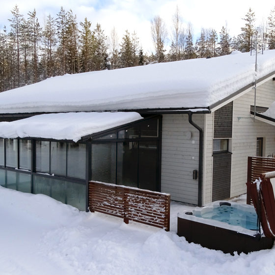Villa Lumikko Cottage from the back with hot tub in Rovaniemi, Lapland, Finland