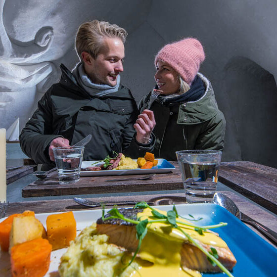 Dinner in ice restaurant in Arctic SnowHotel and Glass Igloos, Rovaniemi, Lapland, Finland