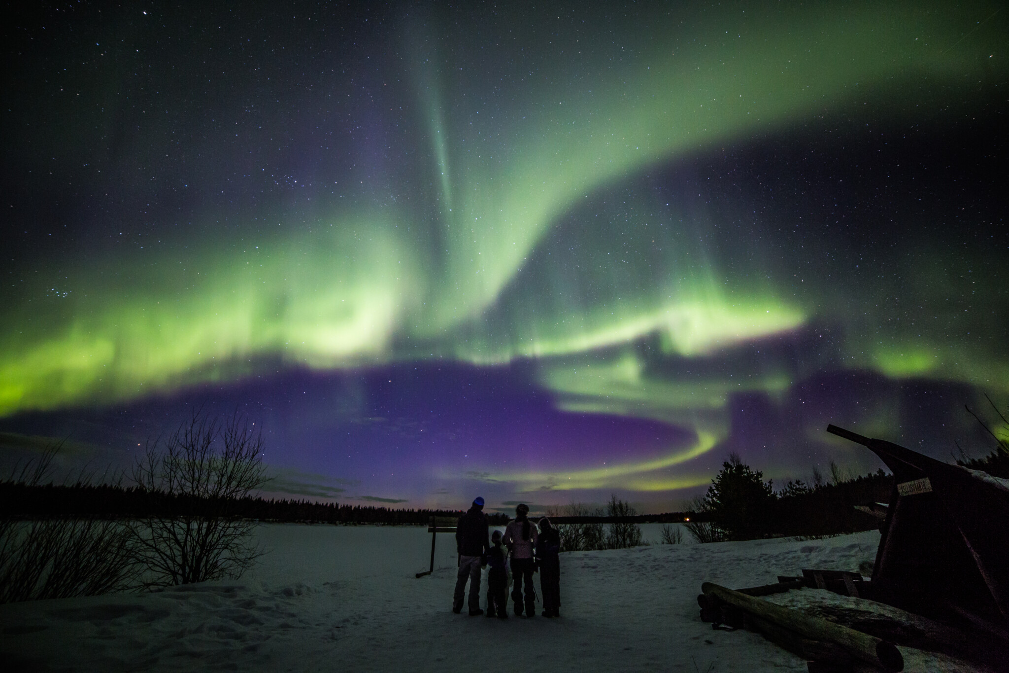 Family under the Northern Lights in Rovaniemi Lapland Finland Photo by Juho Uutela