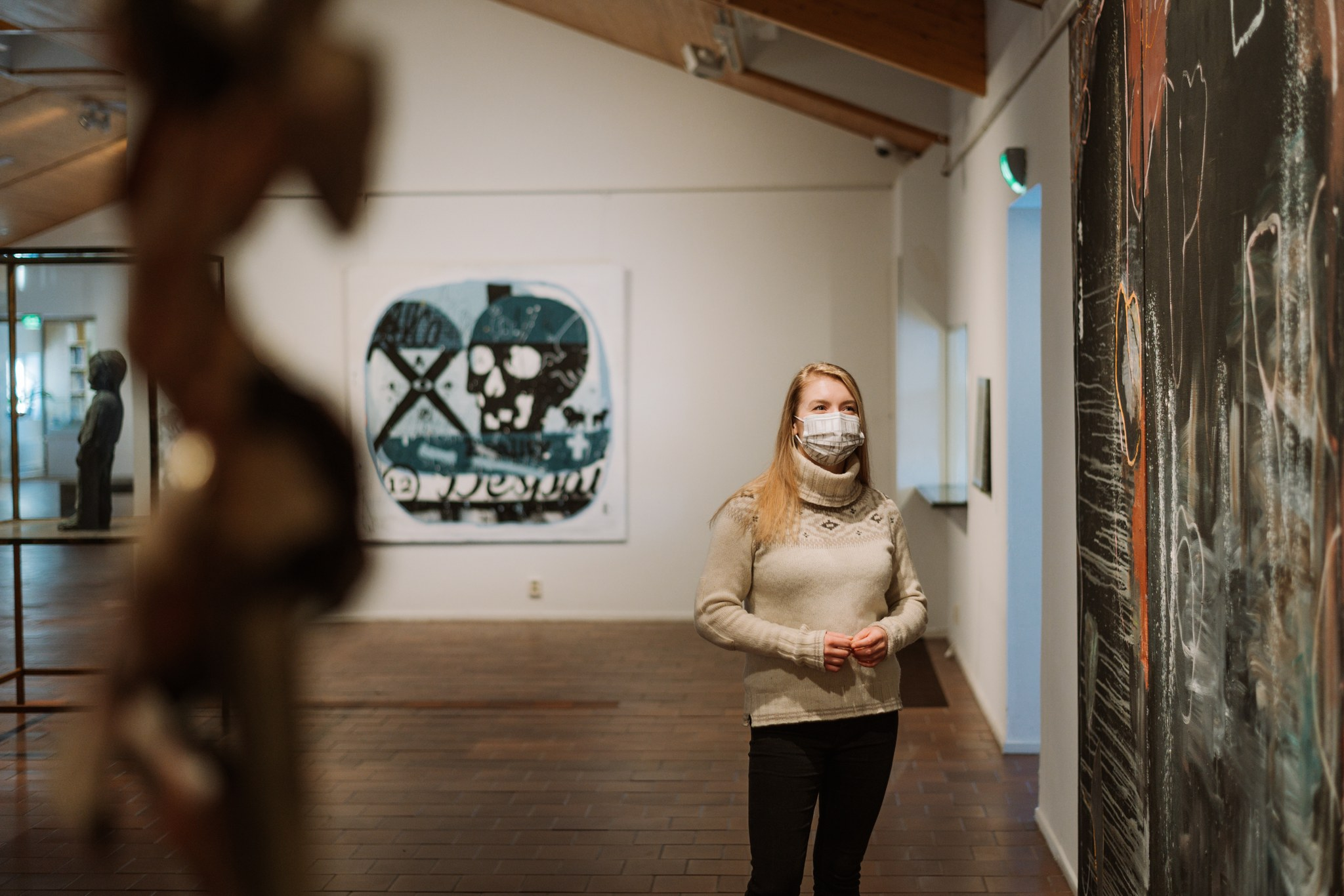 Girl with face mask in culture house Korundi in Rovaniemi Lapland Finland