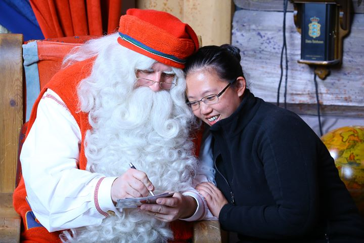 Helen from Taiwan with Santa Claus in Rovaniemi Lapland Finland
