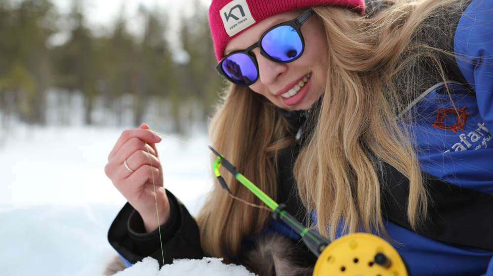 Ice fishing with Safartica in Rovaniemi, Lapland, Finland