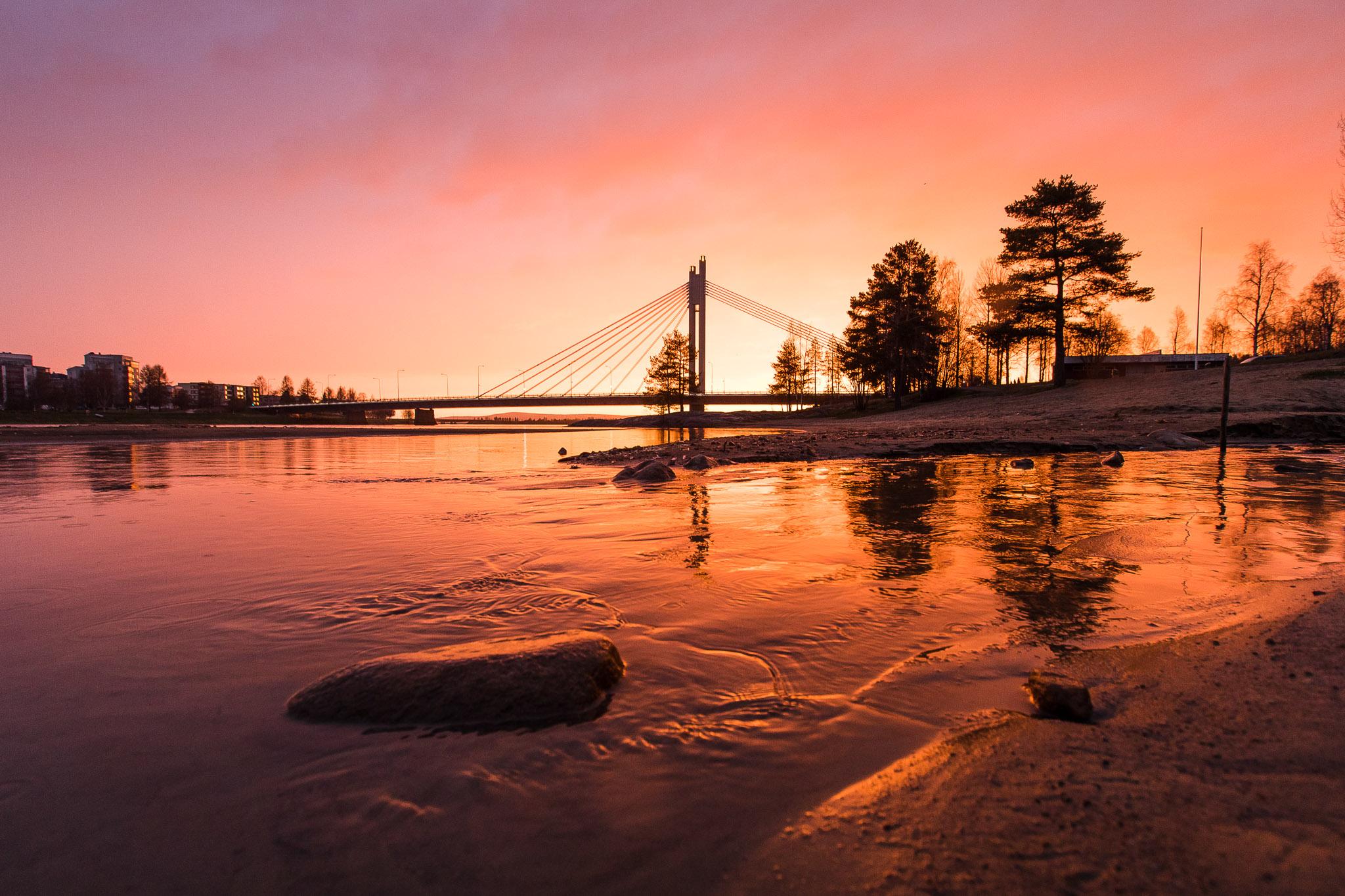 Lumberjacks candle bridge under the midnight sun in Rovaniemi Lapland