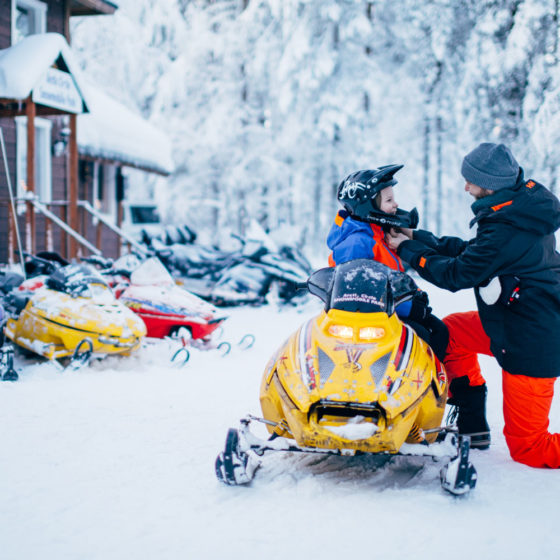 Mini snowmobiling is fun winter activity to children in Rovaniemi, Lapland