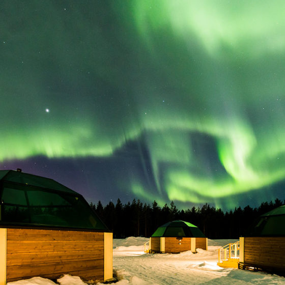 Northern Lights in Arctic SnowHotel Glass Igloos in Rovaniemi, Lapland, Finland