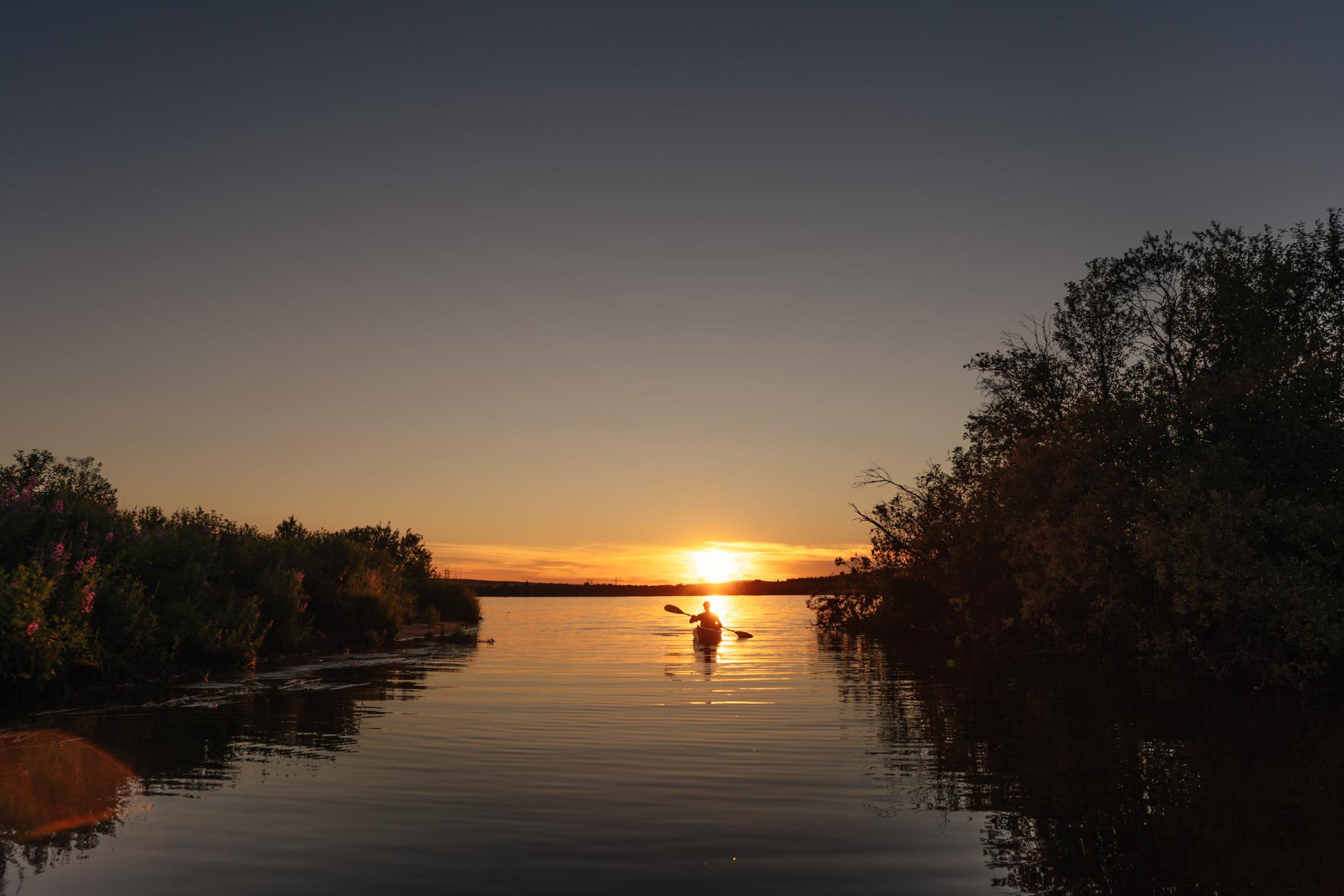 Kayaking under the midnight sun in Rovaniemi Lapland