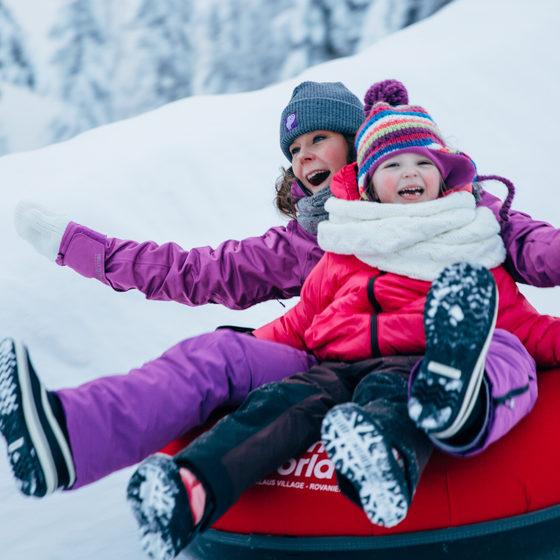 Ice Sliding in Snowman World Winter Zone in Rovaniemi, Lapland, Finland