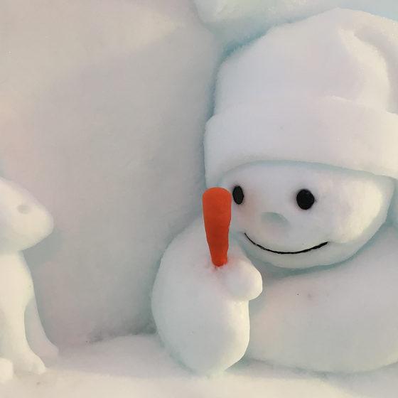 Snowman World Snowman and rabbit snow sculpture at Santa Claus Village, Rovaniemi, Lapland, Finland