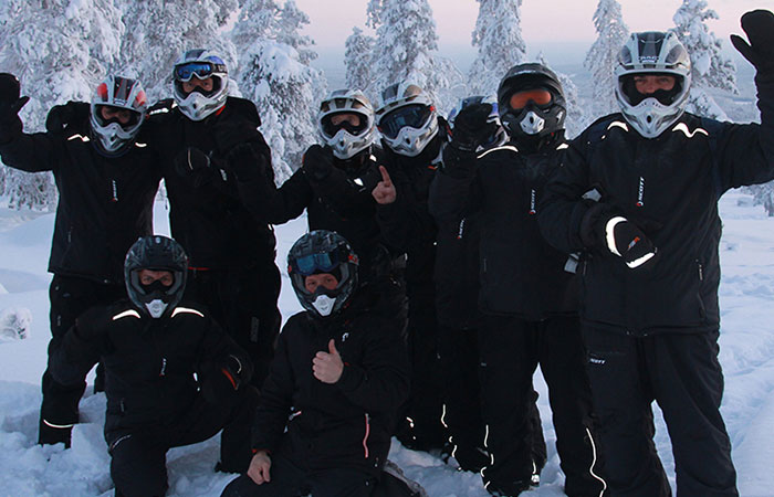 Happy group after snowmobiling programme by Rovaniemi Congresses
