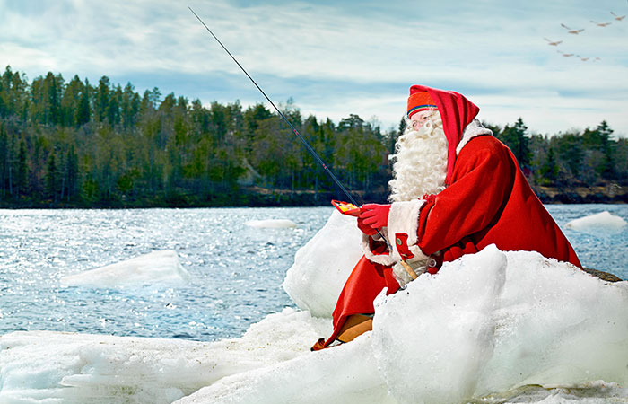 Santa Claus fishing in Rovaniemi, Lapland, Finland