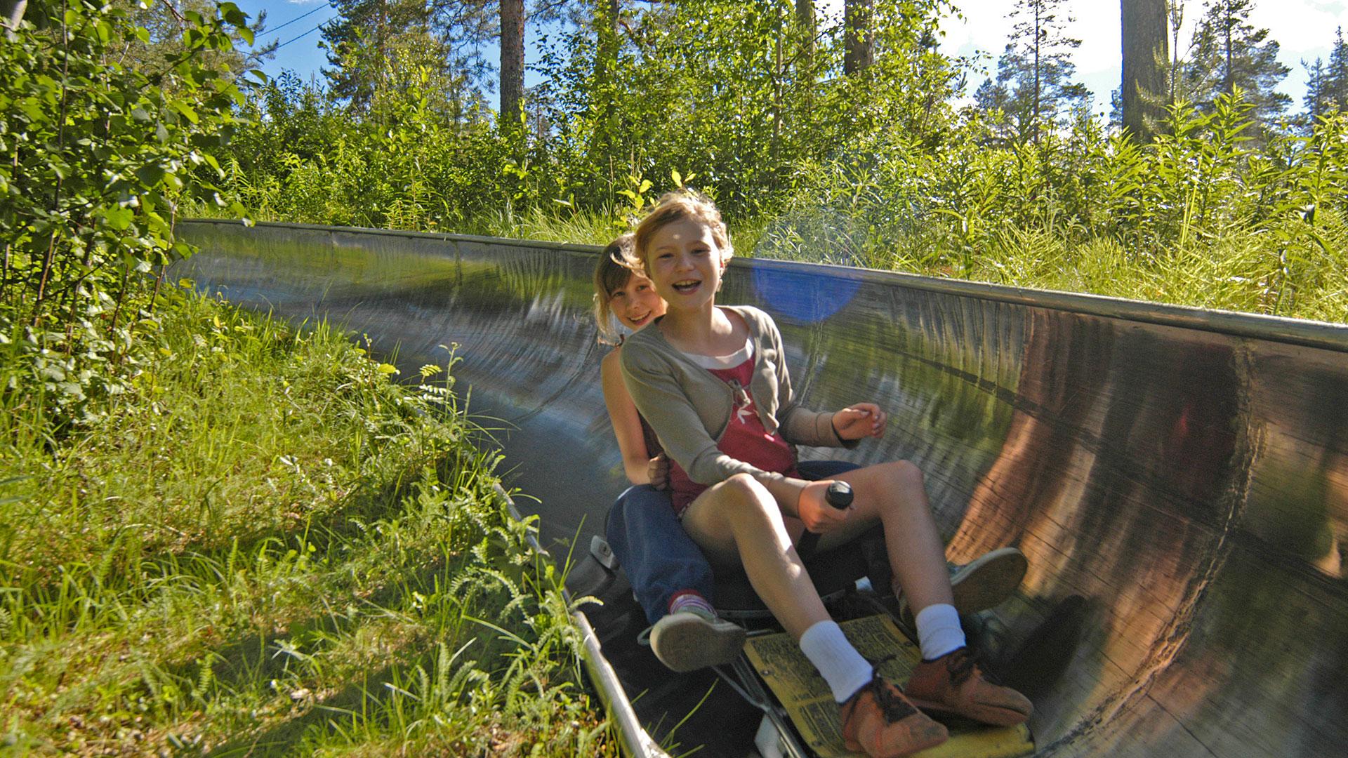 Summer bobsledding in Ounasvaara ski centre in Rovaniemi, Lapland, Finland