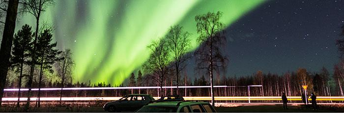 Aurora Borealis over a road in Rovaniemi, Lapland, Finland