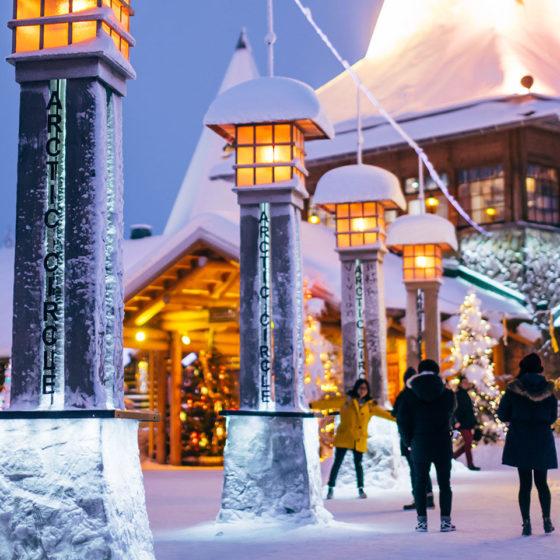 Crossing the Arctic Circle in Santa Claus Village in Rovaniemi, Lapland, Finland