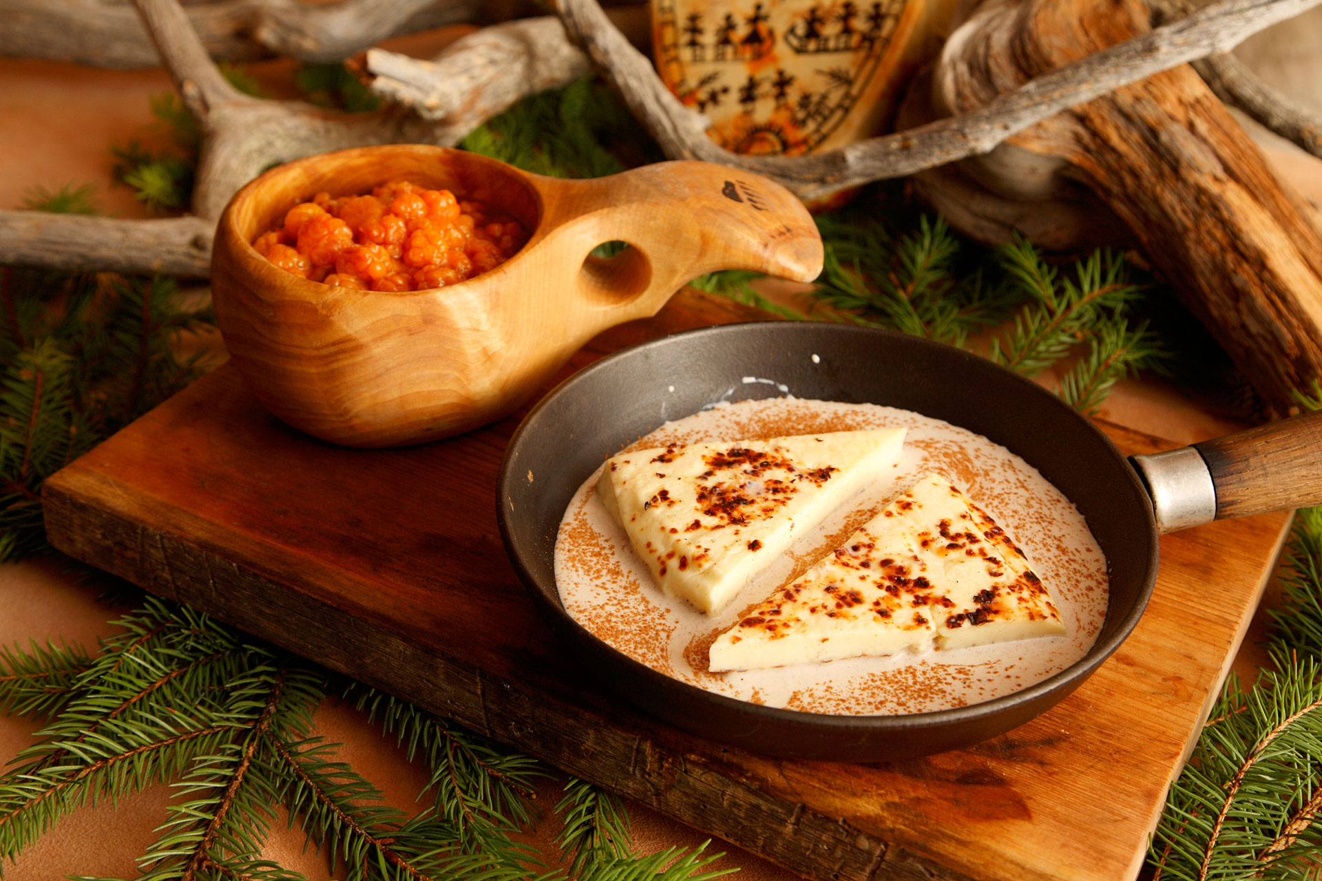 """Bread cheese"", a Lappish speciality served with cloudberries in Rovaniemi, Lapland, Finland"