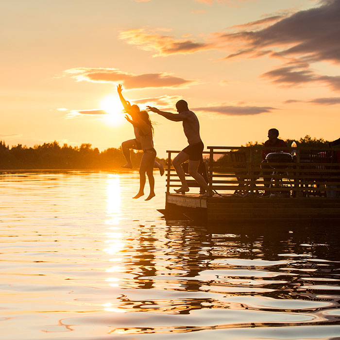 Jumping into river Ounasjoki for a swim under the Midnight Sun in Rovaniemi