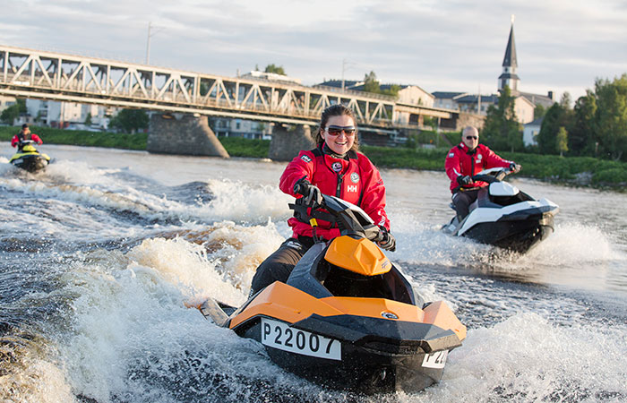 Jet skiing on the Kemijoki river in central Rovaniemi, Lapland, Finland