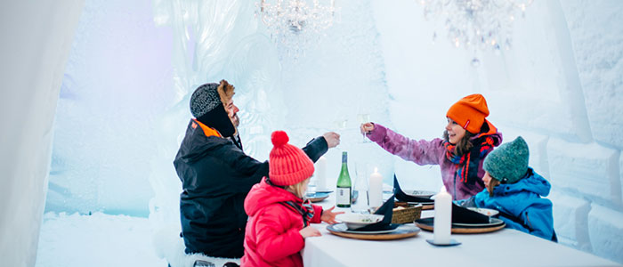 Cool family dinner in Snowman World ice restaurant in Rovaniemi, the Official Hometown of Santa Claus
