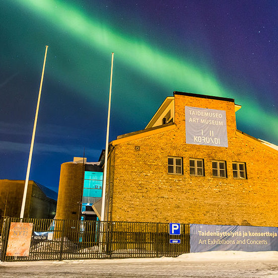 The Northern Lights over Korundi House of Culture in Rovaniemi, Lapland, Finland