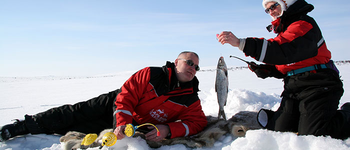 visit-rovaniemi-winter-activities-lapland-safaris-ice-fishing